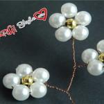 Accessori per capelli: fiori di perle intrecciati